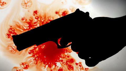 Pistol silhouette against bloody background Acción en vivo