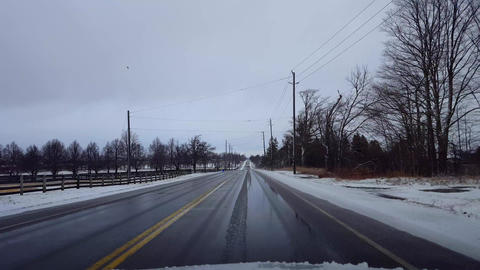 Driving Rural Countryside Road in Winter With Snow on Side of Road in Day. Driver Point of View POV Live Action