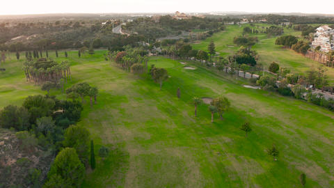Aerial view. Empty golf course. Breathtaking sunset shining on golf course Live Action