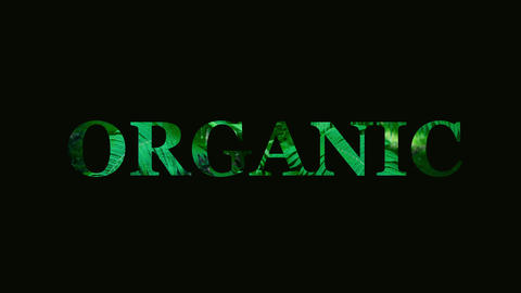The word organic makes a glitch. The word organic on a background of plants Live Action