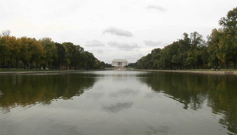 A long shot of the Lincoln Memorial across the reflecting... Stock Video Footage