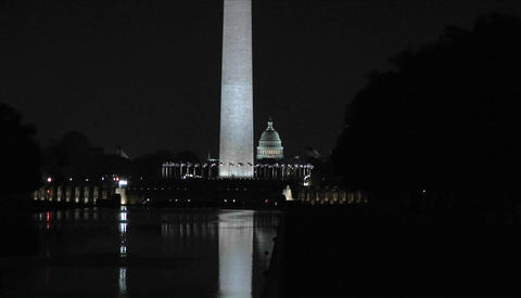 The Capitol Building and Washington monument at night Stock Video Footage