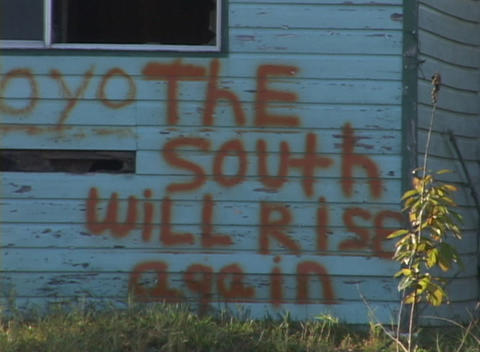 Graffiti on a building reads The South Will Rise Again Stock Video Footage