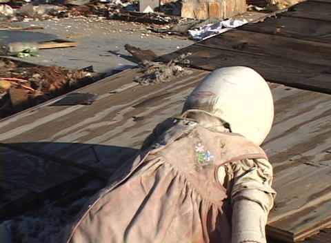 Zoom out on a doll in the rubble left from Hurricane Katrina Footage