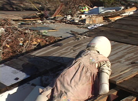 Zoom out on a doll in the rubble left from Hurricane Katrina Stock Video Footage
