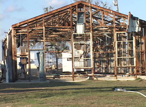 Medium shot of the frame of a house stripped bare by... Stock Video Footage