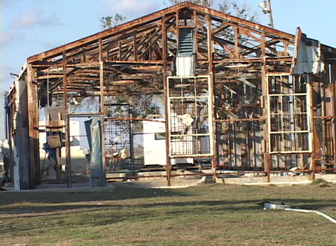 Medium shot of the frame of a house stripped bare by Hurricane Katrina Footage
