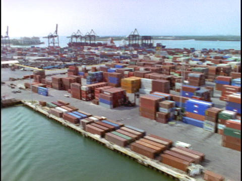 Cargo containers fill a dock in this aerial shot over the Pot of Miami Footage