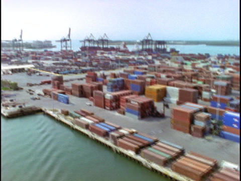 Cargo containers fill a dock in this aerial shot over the... Stock Video Footage