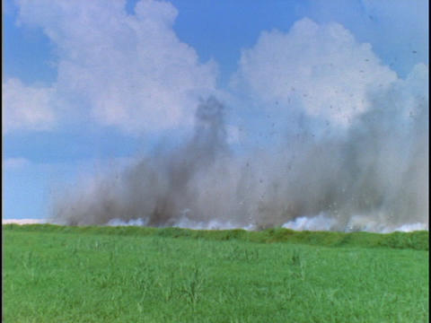 Dynamite blasts limestone at a Florida stripmine Stock Video Footage