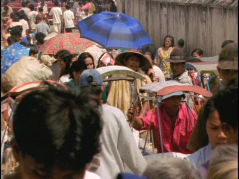 Pedestrians crowd a market in Indonesia Stock Video Footage