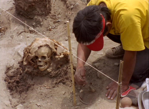 Medium-shot of an archaeological worker carefully... Stock Video Footage