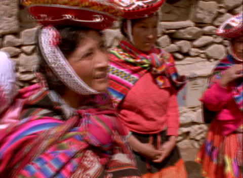 Close-up of colorful Peruvian women chatting Footage