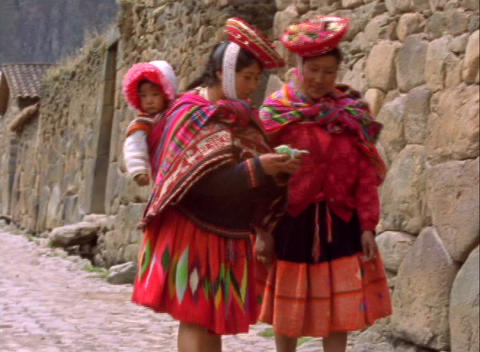Hand-held shot of two Peruvian women walking along a... Stock Video Footage