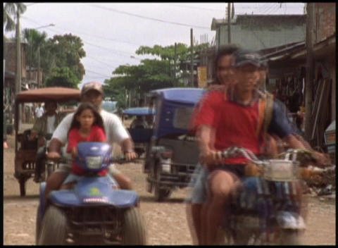Medium-shot of local people driving a variety of small... Stock Video Footage