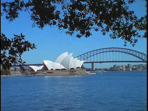The Sydney Opera House and Bridge are situated on... Stock Video Footage