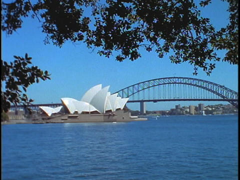 The Sydney Opera House and Bridge are situated on Bennelong Point in Sydney Harbor Footage