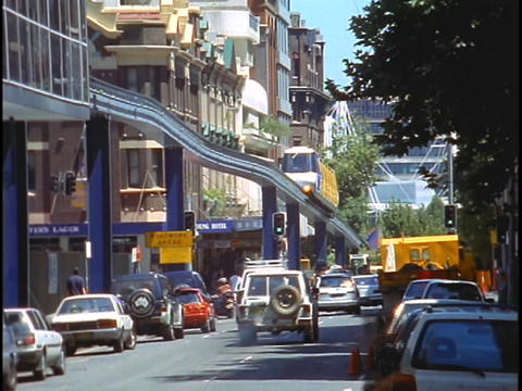 A monorail runs through downtown Sydney with street... Stock Video Footage