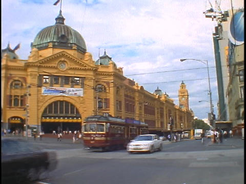 Traffic travels a street of downtown Melbourne, Australia Stock Video Footage
