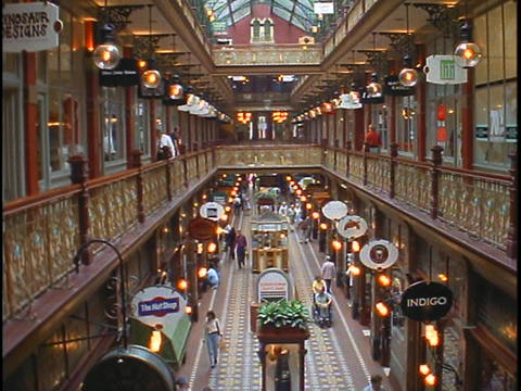Shoppers walk in an elegant shopping mall in Australia Stock Video Footage