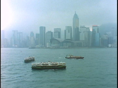 The Star Ferry crosses the harbor outside Hong Kong Footage