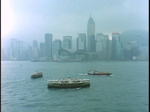 The Star Ferry crosses the harbor outside Hong Kong Stock Video Footage