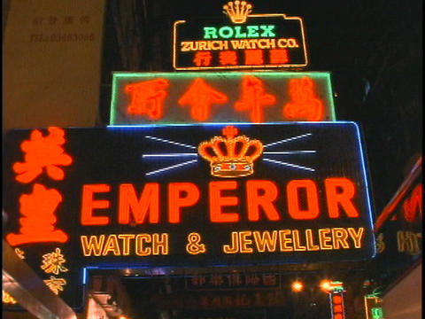 Buses drive beneath the Emperor Watch and Jewelry store... Stock Video Footage