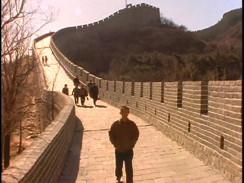 Sightseers walk along the Great Wall Of China Stock Video Footage