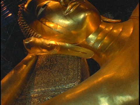 A golden Buddha statue sits in a temple in Bangkok, Thailand Stock Video Footage