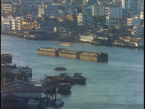 A shipping barge moves along the Chao Praya River in... Stock Video Footage