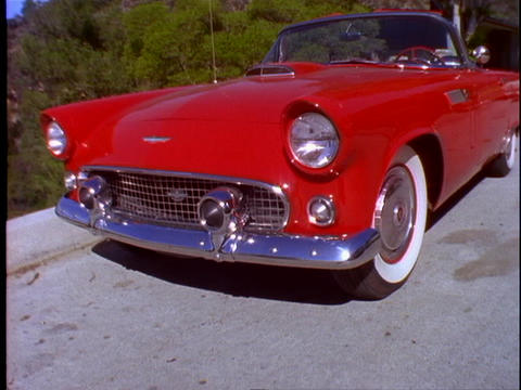 A classic Ford Thunderbird car is parked on a street... Stock Video Footage