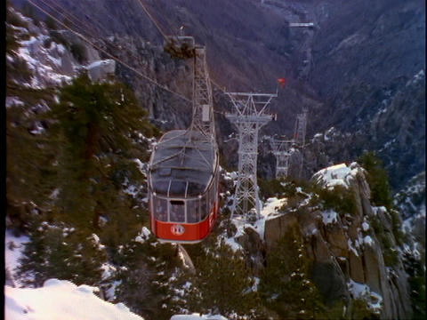 A ski tram moves up the side of a steep mountain in Palm Springs, California Footage