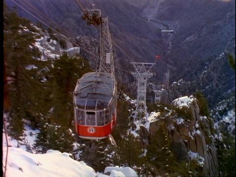 A ski tram moves up the side of a steep mountain in Palm... Stock Video Footage