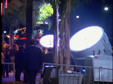 Searchlights light up the night sky in Hollywood, CA... Stock Video Footage