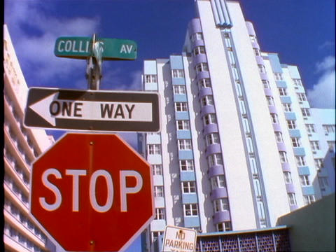 A stop sign, one way sign and a street sign stands in... Stock Video Footage