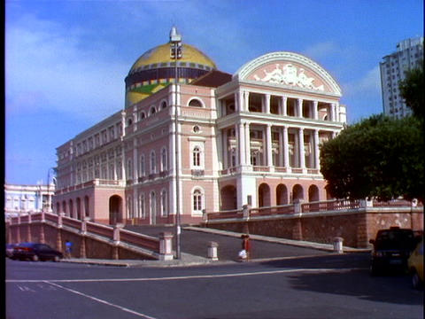 Pedestrians walk past the Manaus opera house in Brazil Stock Video Footage