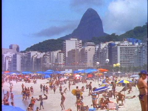 Sunbathers lie in the sand on Copacabana beach in Rio De... Stock Video Footage