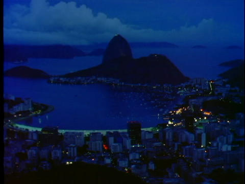 Corcovado mountain is silhouetted against the ocean... Stock Video Footage
