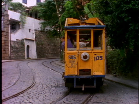 A dog chases a trolley driving through the streets of Rio... Stock Video Footage