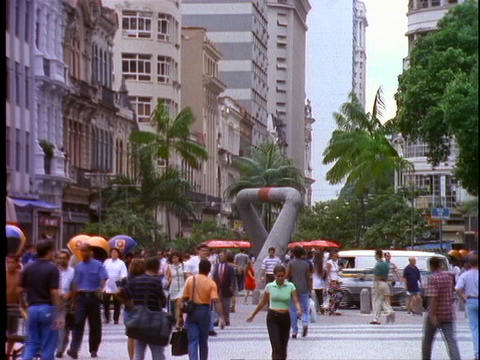 Shoppers and pedestrians walk through a shopping district in Rio De Janeiro, Brazil Footage
