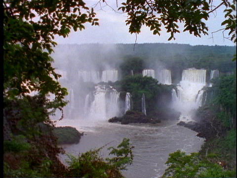 Water crashes over the Iguacu Falls in Argentina Stock Video Footage