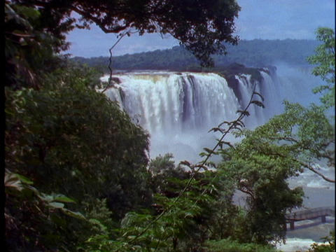 The Iguacu Falls pour into the jungle at the Brazil and Argentina border Footage