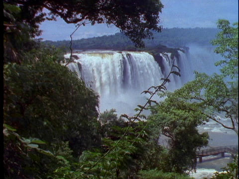 The Iguacu Falls pour into the jungle at the Brazil and... Stock Video Footage