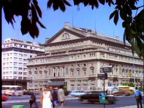 Pedestrians and traffic pass public buildings in Buenos Aires, Argentina Live Action