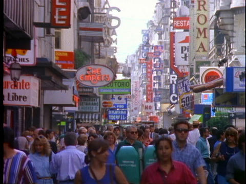 Pedestrians wander through the shopping district of Buenos Aires, Argentina Live Action