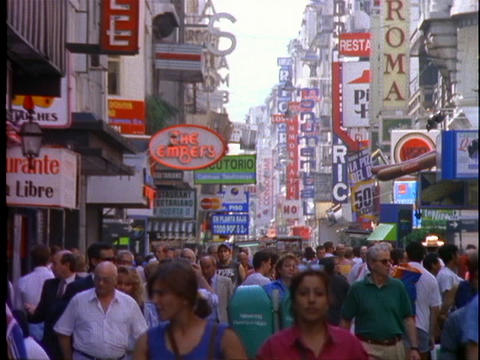 Pedestrians wander through the shopping district of... Stock Video Footage