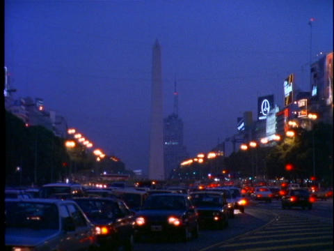 Traffic drives through downtown Buenos Aires, Argentina... Stock Video Footage