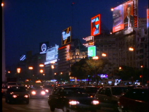 Neon signs light up the night in Buenos Aires, Argentina Stock Video Footage