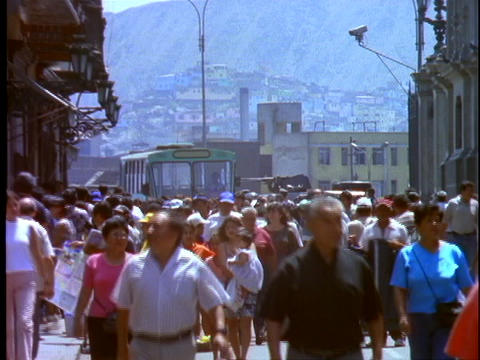 Pedestrians crowd the downtown area of Lima, Peru Stock Video Footage