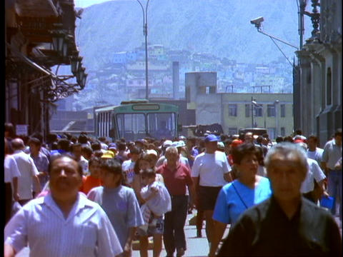 Pedestrians crowd the downtown area of Lima, Peru Live Action